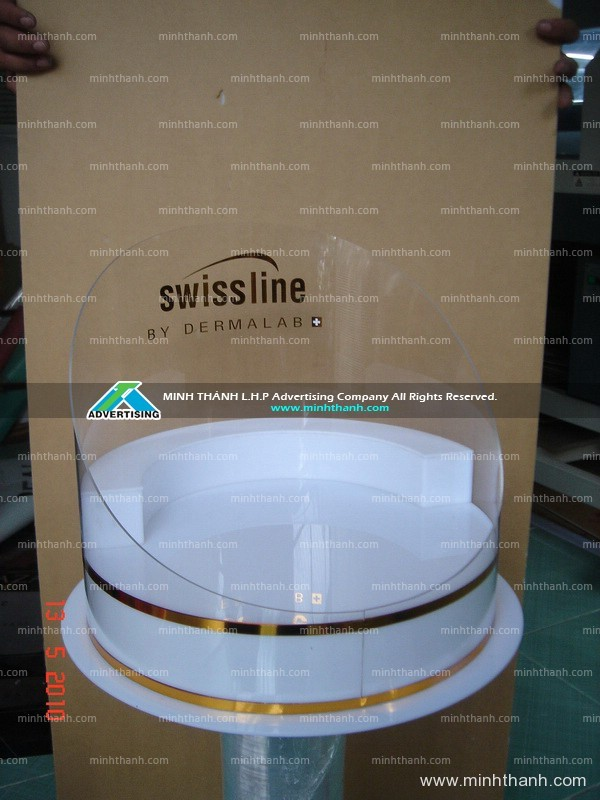 Produce acrylic shelf displaying Swissline cosmetics